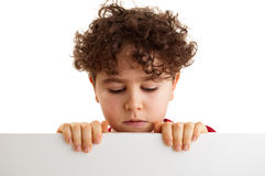 Boy holding blank board board Stock Photography