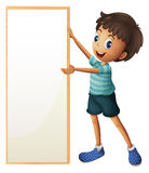 A boy holding a blank framed board Royalty Free Stock Images