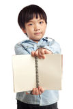Boy holding blank notebook Stock Images