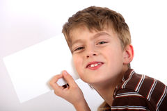 Boy holding the blank page Stock Images