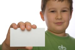 Boy holding blank paper Stock Images