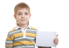 Boy holding blank sheet of paper Royalty Free Stock Photos