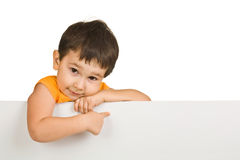 Boy holding a blank sign Royalty Free Stock Photo