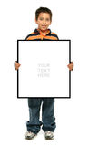 Boy holding a blank sign stock photos