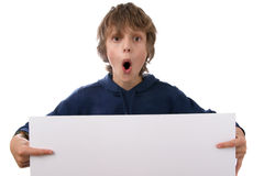 Boy holding blank white sign. On white background Royalty Free Stock Photos