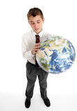 Boy holding blow up ball of the Earth world Royalty Free Stock Photo