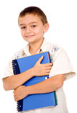 Boy holding a blue notebook Stock Images