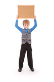 Boy holding a board made of cork Stock Photos