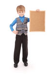 Boy holding a board made of cork Stock Images