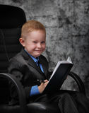 Boy holding book Stock Images