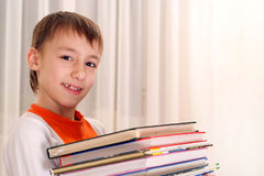 Boy holding a book Stock Photography