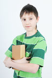 A boy holding a book Stock Photography