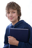 Boy holding book. On white background Stock Photography
