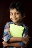 Boy holding a book Stock Photos