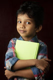 Boy holding a book Stock Images