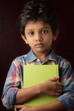 Boy holding a book Stock Photos