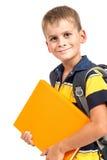 Boy holding books Stock Image