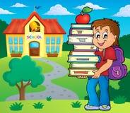 Boy holding books theme image 2 Royalty Free Stock Photo