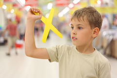Boy holding boomerang toy Royalty Free Stock Photography