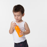 Boy holding a bottle Royalty Free Stock Photos
