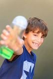 Boy holding bottle Royalty Free Stock Images