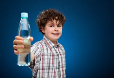 Boy holding bottle of water Stock Photo