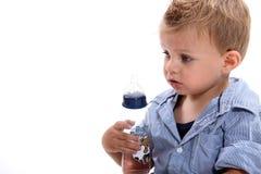 Boy holding bottle Stock Photos