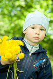 Boy holding a bouquet Royalty Free Stock Photography
