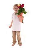 Boy holding a bouquet Stock Photos