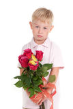 Boy holding a bouquet Stock Image