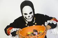 Boy Holding Bowl Of Candies In Halloween Outfit Royalty Free Stock Photos
