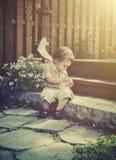 Boy Holding a Broken Egg - Retro Royalty Free Stock Photography