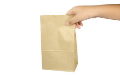 Boy holding a brown paper bag in his hand. Stock Photography