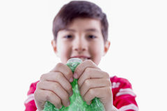 Boy holding bubble wrap. Stock Photos