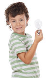 Boy holding bulb Stock Photos