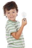 Boy holding bulb Stock Photos