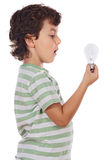 Boy holding bulb Royalty Free Stock Images