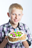 Boy holding a cake Royalty Free Stock Images