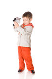 Boy holding camera Royalty Free Stock Image