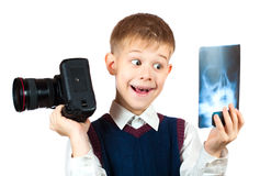 Boy is holding camera and taking X-ray photo Stock Image