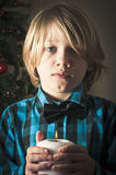 Boy holding a candle Stock Photo
