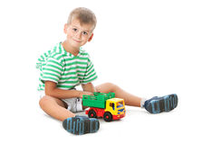 Boy holding a car Stock Images