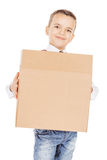Boy holding card boxes against on white studio background. stock image