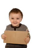 Boy holding a  cardboard Royalty Free Stock Image