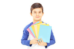 Boy holding cards in different colors and looking at camera Royalty Free Stock Image