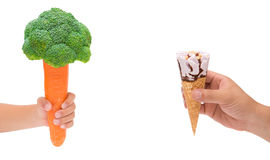 Boy holding carrot with cauliflower and man holding ice cream cone on white,healthy eating concept Royalty Free Stock Photography