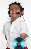 Boy holding cd with headphone. Asian boy holding cd with headphone Royalty Free Stock Photos