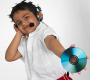Boy holding cd with headphone Stock Photo