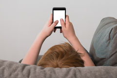 Boy Holding Cellphone Royalty Free Stock Images