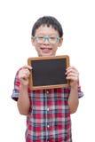 Boy holding chalkboard over white Royalty Free Stock Photos